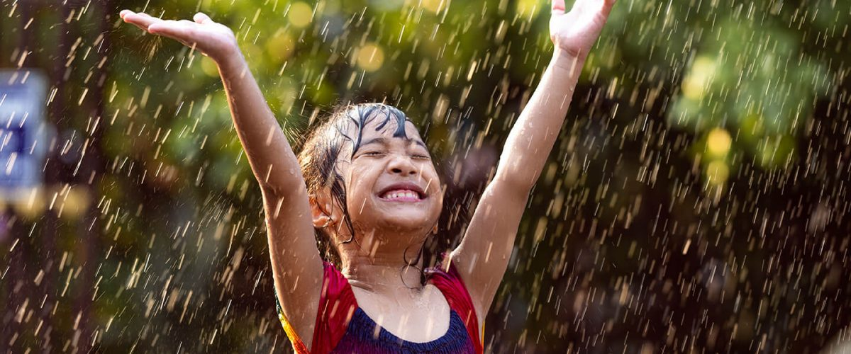 asian-children-playing-in-the-rain-are-happy